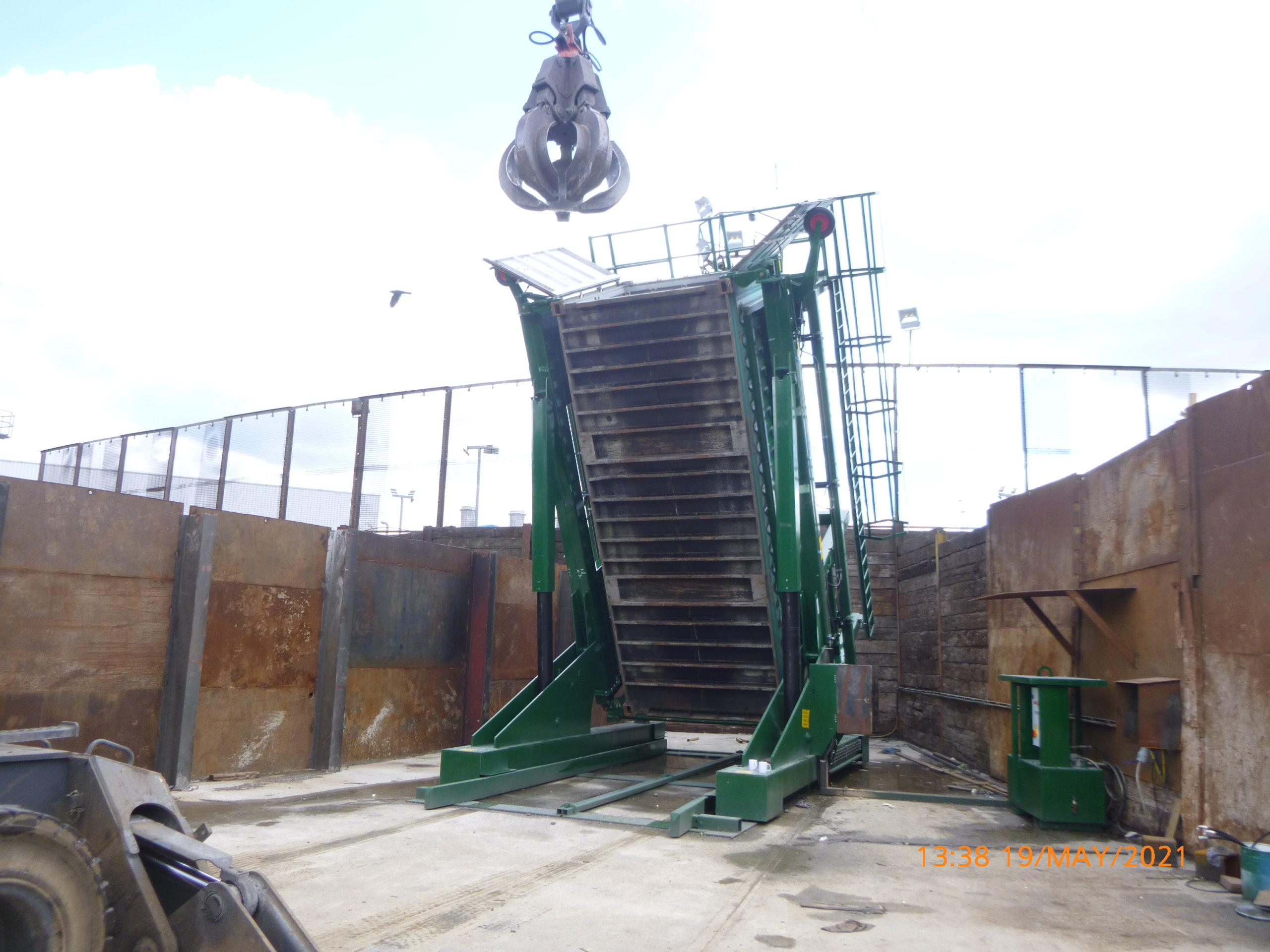 Loading a container with scrap metal