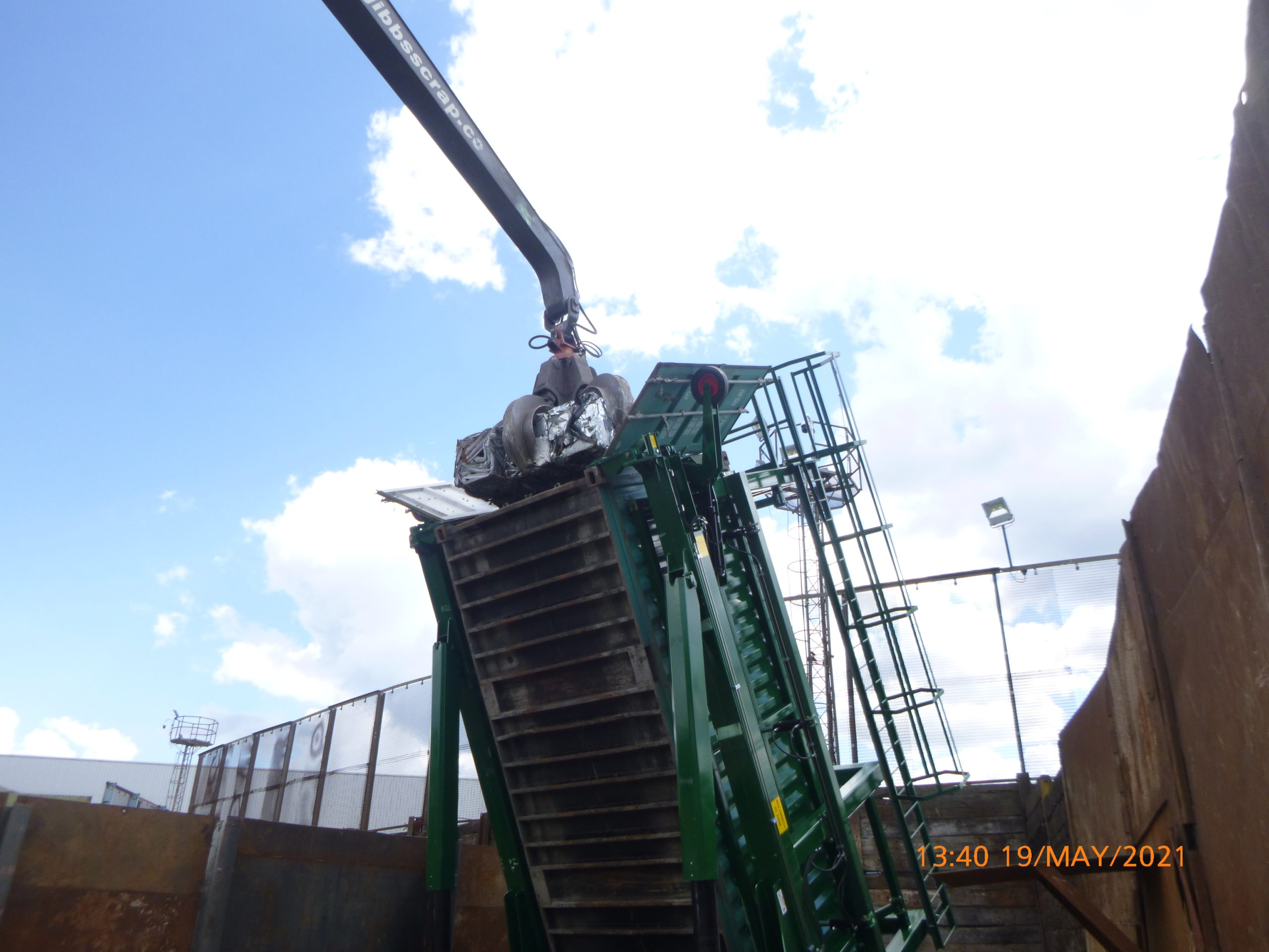 The Loading of a container with scrap metal.